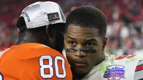 Ohio State linebacker Raekwon McMillan congratulates Clemson players after the Fiesta Bowl.