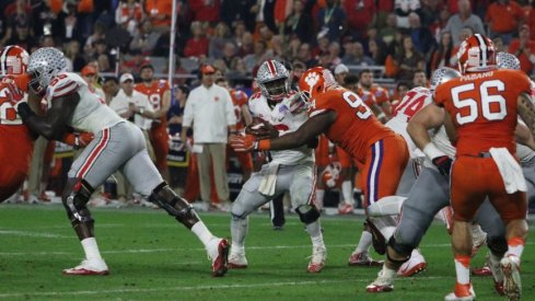 J.T. Barrett and his backfield mates had little room to operate against a stout Clemson front.