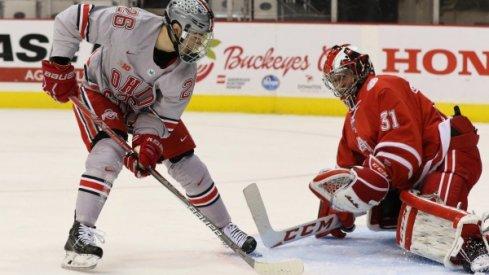 Ohio State forward Mason Jobst scores a goal on Miami goalie Ryan Larkin.