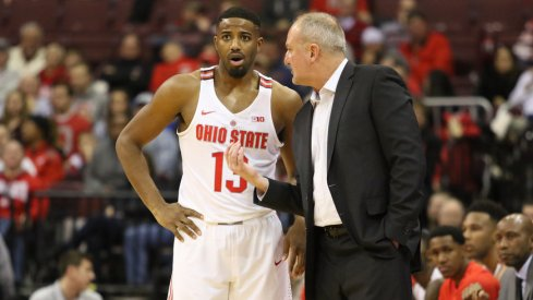 Ohio State's JaQuan Lyle and Thad Matta have a conversation.