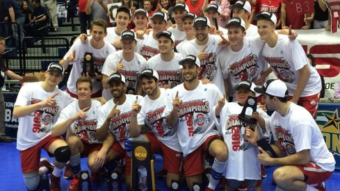 The Ohio State Men's Volleyball team poses with the national championship trophy after clinching the victory over BYU in 2016.
