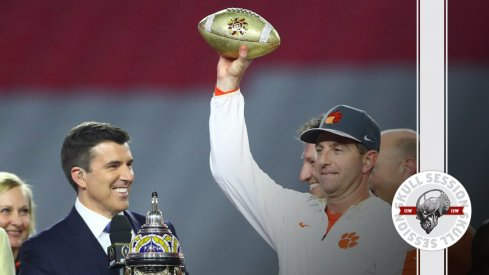 Dabo Swinney lifts the January 2nd 2016 Skull Session over his head.