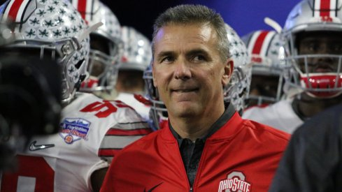 Urban Meyer prepares to lead his team on the field for the Fiesta Bowl.