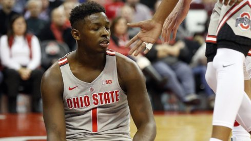 Ohio State's Jae'Sean Tate sits on the floor against Purdue.