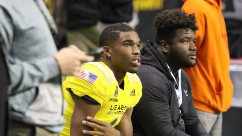 Jeffery Okudah and Marvin Wilson look on at the Army All-American Bowl.