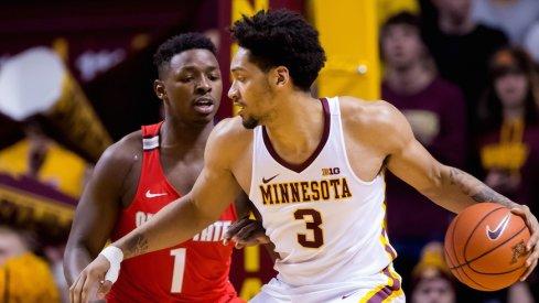 Ohio State's Jae'Sean Tate defends Minnesota's Jordan Murphy.