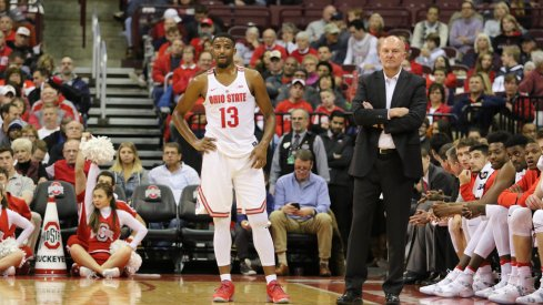 JaQuan Lyle and Thad Matta stand in front of Ohio State's bench earlier this season.