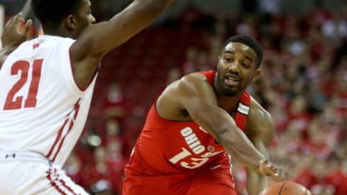 Ohio State point guard JaQuan Lyle makes a pass at Wisconsin.