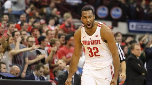 Ohio State center Trevor Thompson celebrates a block against Michigan State.