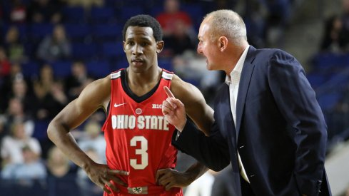 Thad Matta speaks with point guard C.J. Jackson earlier this season.