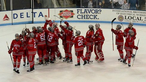 Ohio State men's hockey celebrates a 6-3 victory over Penn State.