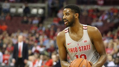 Ohio State point guard JaQuan Lyle pump fakes against Minnesota.