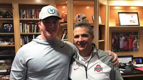 Minneapolis Edna Senior sophomore offensive tackle Quinn Carroll with Urban Meyer in the coach's office.