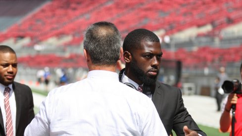 J.T. Barrett meets with Urban Meyer prior to a game last season.