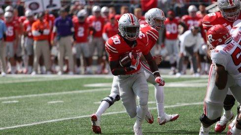 Demario McCall scores a touchdown against Rutgers in 2016