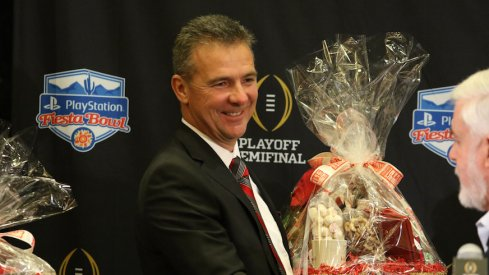 Urban Meyer receives $160,000 retention bonus, sees buyout in contract drop nearly $6.1 million on Wednesday.
