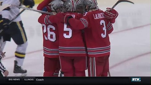 Ohio State players celebrate a goal against Michigan.