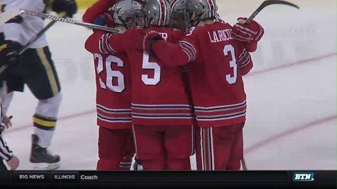 Ohio State players celebrate a goal against Michigan.