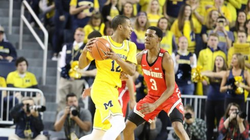 C.J. Jackson guards a Michigan player in the game on Saturday.