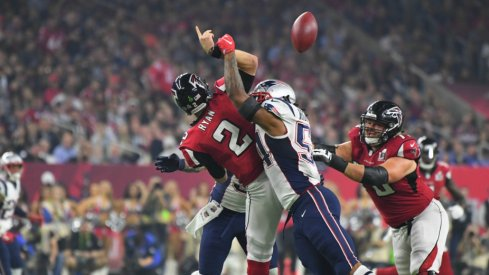 Atlanta QB Matt Ryan is hit while throwing during Super Bowl LI against New England