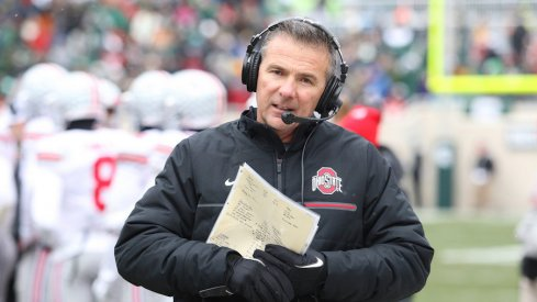 Though it is his offense, Urban Meyer wants his trust his offensive coordinator enough where he can focus on other things as head coach.