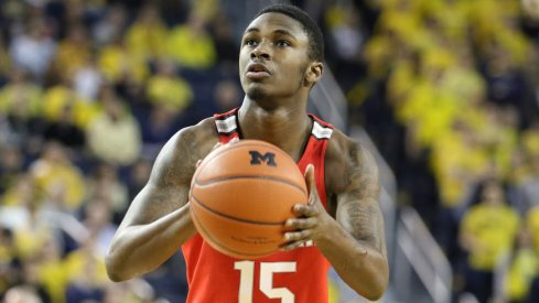 Ohio State guard Kam Williams shoots a free throw at Michigan.