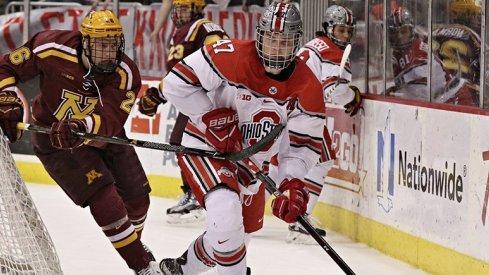Ohio State defenseman Josh Healey skates against Minnesota.