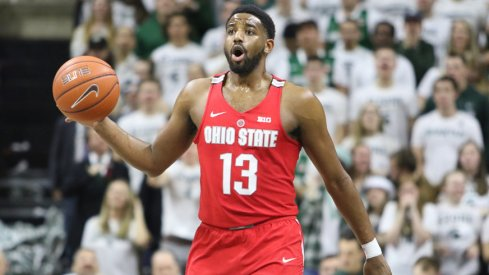 Ohio State point guard JaQuan Lyle dribbles up the court against Michigan State.