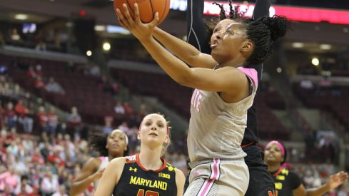 Kelsey Mitchell scores a contested layup against Maryland.