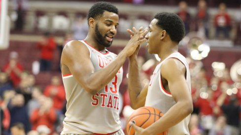 JaQuan Lyle and C.J. Jackson celebrate a win over Wisconsin.