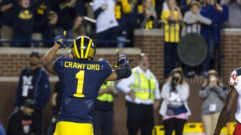 Kekoa Crawford and a talented group of young wideouts will help carry the load in Ann Arbor.