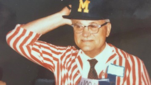 Woody Hayes wearing a Michigan hat.