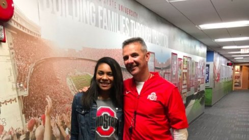 Zeke's siter and Urban Meyer.