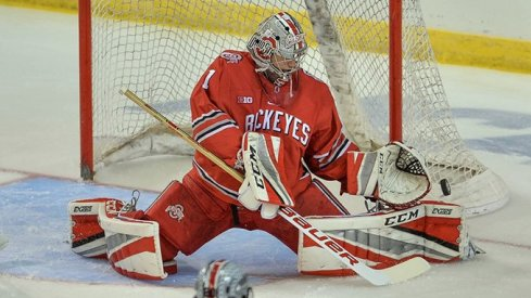 Matt Tomkins makes a save in the Buckeyes' NCAA opener against Minnesota-Duluth.