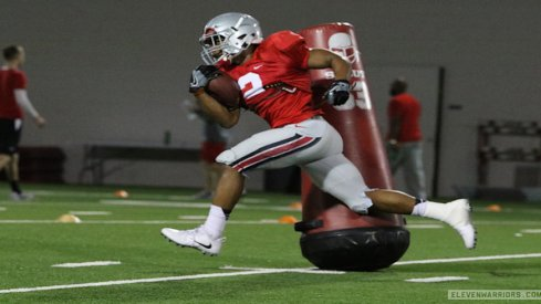 J.K. Dobbins passes Antonio Williams.
