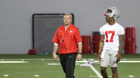 Ohio State LBs coach Bill Davis and Jerome Baker walk off the practice field.