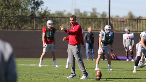 Urban Meyer coaches up his team during spring practices