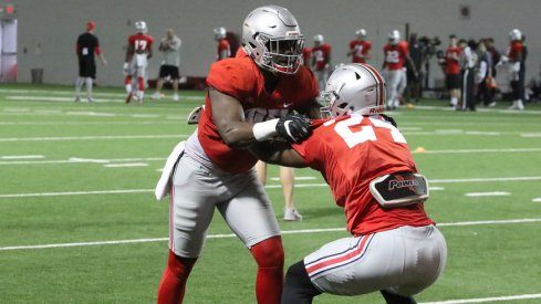 Ohio State tight ends A.J. Alexander and Kierre Hawkins work during a recent spring practice.