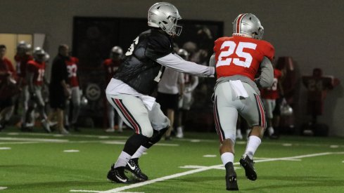 J.T. Barrett hands off to Mike Weber during spring practice.