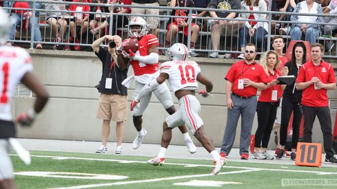 Johnnie Dixon hauls in a pass over Kendall Sheffield.