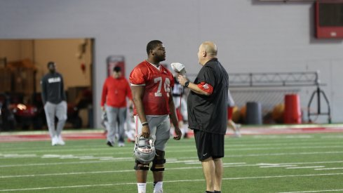 Ohio State's Jamarco Jones talks to Greg Studrawa during the spring.
