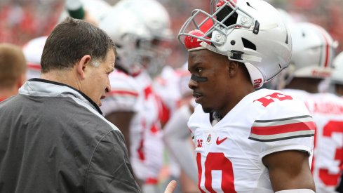 Ohio State safeties coach talks to Kendall Sheffield at the spring game.
