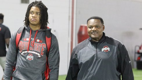 Ohio State signee Chase Young with defensive line coach Larry Johnson.