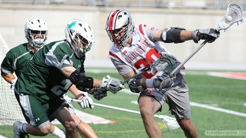 Ohio State's Eric Fannell moves against Loyola defenders in an NCAA Championship lacrosse game.