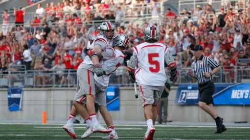 Ohio State men's lacrosse after a win in Ohio Stadium against Loyola Maryland.