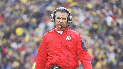 Urban Meyer strolls the sidelines at Michigan.