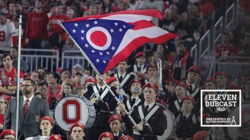 An Ohio State band member waves the Ohio state flag