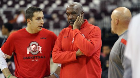 Ohio State assistant coach Greg Paulus and athletic director Gene Smith.