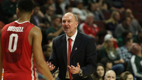 D'Angelo Russell and Thad Matta.