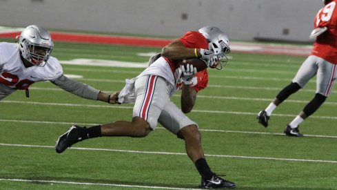 Ohio State's Brendon White is moving to safety.